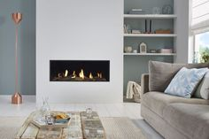 If you are looking to give your room a focal point or something to highlight it, look no further than the fireplace mantel that's already there. Many tend to leave their fireplace mantels bar… Home Fireplace, Modern Fireplace, Fireplace Design, Fireplace Kitchen, Fireplaces, Gas Fires, Home And Living, Modern Living, Living Room Decor
