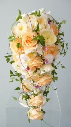 Shower bouquet of David Austin roses, (peach avalanche roses?)