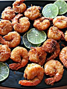 Coconut Lime Battered Shrimp cup bread crumbs finely shredded coconut 1 tbsp finely grated lime zest 1 tsp salt tsp sugar tsp cayenne pepper 2 eggs 18 large, peeled, deveined shrimp, tails on Peanut or Canola oil for frying Fish Recipes, Seafood Recipes, Cooking Recipes, Cookbook Recipes, Cooking Tips, Recipies, I Love Food, Good Food, Yummy Food
