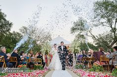 Now this is FUN!  Give Aisle guest a confetti gun and as you walk back up the aisle as MR & MRS have them shoot them off in the air.  AMAZING    www.Idealweddings.net