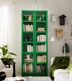 love the painted bookshelf with glass front