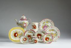 NINE STAFFORDSHIRE PEARLWARE ENAMEL-DECORATED 'KING'S ROSE' TEA WARE, 1815-25.