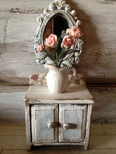 Detail of a shabby chic dollhouse.