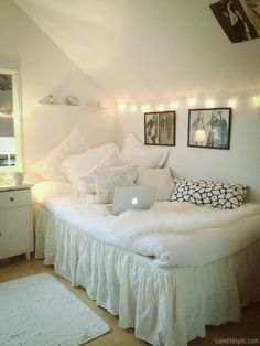 A great, snug style spare room, completely white but fairy lights and lots of layers make it feel really cosy.