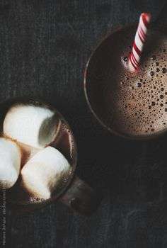 hot chocolate with marshmallows and a peppermint stick