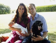 Catherine, Duchess of Cambridge and Prince William, Duke of Cambridge pose for a photograph with their son, Prince George Alexander Louis of Cambridge, surrounded by Lupo, the couple's cocker spaniel, and Tilly the retriever (a Middleton family pet)