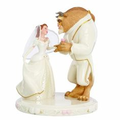 The Lenox Beauty and the Beast Wedding Cake Topper features Belle & the Beast in handpainted Lenox fine china. The Beast is wearing a 24k gold trimmed tux.