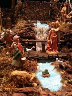 Display Idea - Fontanini Nativity pieces by Roman I have been a collector for 33 years. Water scene using hot glue and colored paper on stacked boxes. Fontanini Nativity, Diy Nativity, Christmas Nativity Scene, Christmas Villages, Christmas Holidays, Christmas Decorations, Nativity Sets, Christmas In Italy, Ceramic Houses
