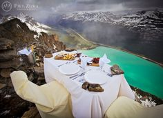 I love Paul Zizka's photography!!! Would love to have a romantic dinner atop the mountains looking down on Lake Louise!