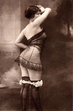 Vintage pinup in stockings and sheer negligee via candiesforeveryone on DeviantArt.