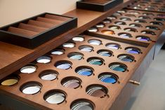 beautiful way to showcase tints/coatings,etc Shoe Store Design, Optometry Office, Retail Branding, Eyewear Shop, Glasses Shop, Optical Shop, Sunglasses Store, Floor Layout, Store Displays