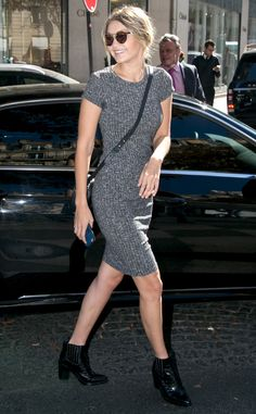Gigi Hadid from Stars at Paris Fashion Week Spring 2016 Gigi is all smiles as she hits the streets in Paris in a form-fitting gray ribbed dress.