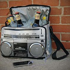 Pump up the jams with your favorite beverages this summer with the boombox cooler. The boombox cooler will take you straight back to the eighties, when it was super sweet to have a boombox on your shoulder. Plus, it keeps your drinks cool in style. Boombox, Take My Money, Gadgets And Gizmos, Cool Stuff, Stuff To Buy, Random Stuff, Diaper Bag, Geek Stuff, Bmw