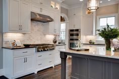Traditional Kitchen with Andromeda White Granite Countertop, Kitchen island, European Cabinets, Flat panel cabinets, L-shaped