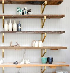 Lovely rustic shelving with brass hardware. Need this in my life!
