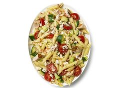 Pasta Salad with Chicken, Cucumber, Cherry Tomatoes and Feta : Bursts of juicy cherry tomatoes, along with crunchy cool cucumber, make this chicken and feta penne salad a bright picnic side. via Food Network Easy Pasta Salad, Pasta Salad Recipes, Recipe Pasta, Cucumber Recipes, Food Salad, Fruit Salads, Quinoa Salad, Food Network Recipes, Cooking Recipes
