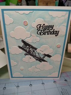 Stampin Up Sale-a-bration Sky is the Limit & Darice clouds embossing folder.