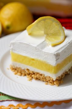 Lemon Lasagna - 4 layers of goodness including a Lemon Oreo crust, cream cheese layer, lemon pudding layer and topped with cream! It's DELICIOUS!