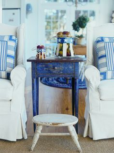 Blue and White - love that chippy blue end table