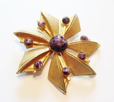 1960's Gold Plated Flower Brooch with purple glass cabochons by RetroroxJewellery on Etsy