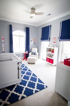 Simple Bold--simple, bold colors (deep blue, bright red, clean white); pattern rug; striped roman shades & curtain combo; accent wall; collapsable storage containers; modern reading chair; monogrammed pillow; and small red side table.