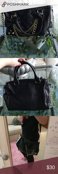 "Black Satchel with Gold Accents🎉 Has been used a lot over the past years, but is still in great condition. -It's faux leather. -On the inside has: 2 pockets on one side & a zipper on the other. -has a long strap(so it can be used as a Crossbody) and two handles. -Has cute gold accents(as shown). -I'm 5'5"" and the long strap makes the purse touch right about to my knees. 💗The long strap is not detachable💗 Claire's Bags Satchels"