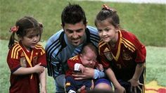 Spanish National Team soccer striker David Villa poses with his children after the training session