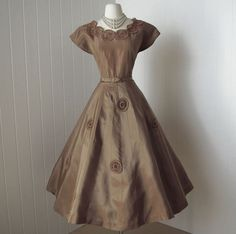 vintage 1950s dress ...designer ANN KAUFFMAN full skirt party dress with crocheted peek-a-boo pinwheels and tulle   -featured item-