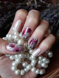 Flower nail stamping sticker and pearl colour nail polish.