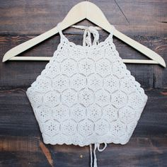 Cream colored halter crochet crop top that features a tie neck and back. Fully lined. Digging the boho vibe. Seen styled with our floral kimono jacket, antalya turkish coin collar, black boo Tops A Crochet, Top Crop Tejido En Crochet, Knit Crochet, Crochet Clothes, Diy Clothes, Bikinis Crochet, Summer Crop Tops, Halter Crop Top, Floral Kimono