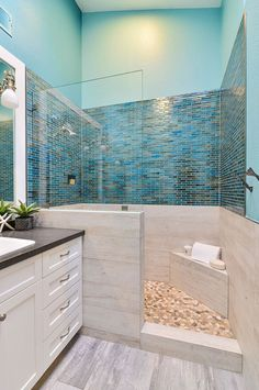 Decorate your coastal bathroom with beautiful accents and stunning blue glass accent tiles. (Designed by Bonnie Bagley Catlin of Signature Designs Kitchen Bath)