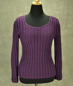 This is a simple, classic pullover with an easy mock cable stitch pattern. It has a slightly more formal sensibility due to the edges that integrate with the overall pattern. The stretchy nature of the stitch pattern provides a little waistline definition. The open scoop neckline is high enough to be modest and yet low enough to show a little skin, adding length to the neck. All sections are worked bottom up.
