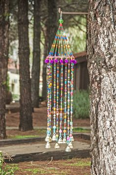 decorate shop Boho home decor wind chimes, colorful beaded mobile with Brass bells, This mobile is made from round wooden surfaces covered with fabric, pompoms & embroidery. The strands Suncatchers, Mobiles, Handmade Wire Jewelry, Diy Wind Chimes, Summer Crafts For Kids, Beaded Curtains, Swarovski Crystal Beads, Crystals, Bohemian Design