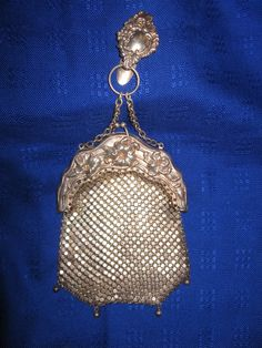 Art Nouveau German Silver Mesh Purse & Chatelaine Monogrammed Clip c.1900 Ornate Flowers Orchid . Not a Whiting and Davis but a piece that provides historical perspective on the mesh purse. They were very popular as chatelaine purses before purses were carried by hand.