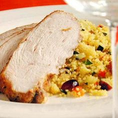 Spice-rubbed turkey breast combines with a colorful pilaf-like side of couscous studded with orange-soaked cranberries.