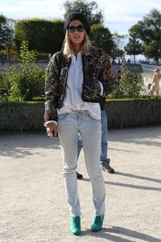 Beanie, brocade, white shirt and jeans.  what a mix!