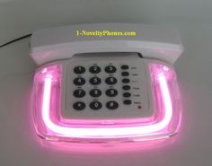 In honor of the new iPhone 4S that I purchased today, I thought I would post a pic of the other coolest phone I ever owned: the pink neon phone~