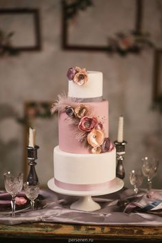Dusty pink, mauve, pale rose wedding cake with feathers and silk flowers by marzipan-wedding.ru