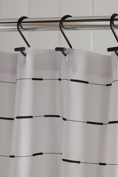 If you think shower curtains aren't an important element in your bathroom's decorating scheme, think again. Just as the perfect necklace can complete an outfit, shower curtain hooks can be the finishing touch your curtain is craving. This set of twelve sleek and modern hooks are just the ticket to upgrade the look of your washroom. Made with a black finish and boasting sleek lines, they have a clean form that is sure to get noticed. Shower Curtain Hooks, Shower Curtains, Bathroom Collections, Washroom, Ticket, Touch, Decorating, Outfit, Modern