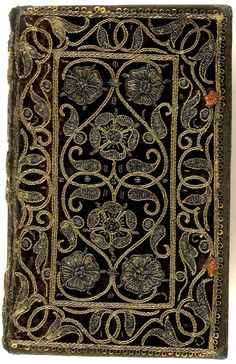 Embroidered velvet book with scroll and floral pattern. Orationis Dominic: explicatio (Geneva, 1583), collection: