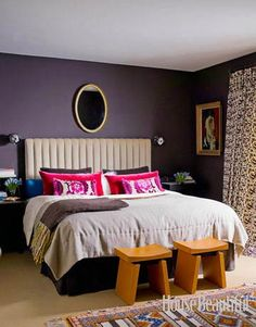 A Dark and Cozy Bedroom  This master bedroom of modern appeal designed by Moises Esquenazi is dark and cozy, with walls in Farrow & Ball Mahogany No. 36. The mohair velvet headboard is by the designer.