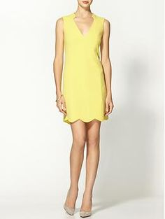 Love the subtle detailing along the neckline and hem of this Rachel Roy Scallop Dress.