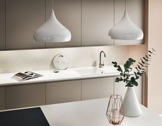 Make a statement in your kitchen with distinctive pendant lights. The perfect way to add focus to your kitchen island. Featured in our Clerkenwell Matt Cashmere kitchen range from our Contemporary Collection. Take a look at Howdens for kitchen inspiration.