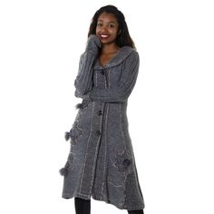 This classy cardigan offers style, warmth and comfort with long sleeves and an open v-neck style. The button up front offers versatility in cooler weather.