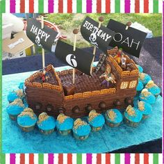 """Pirate ship cake and gold coin cupcakes with buttercream #pirateshipcake #pirateship #goldcoincupcake"""