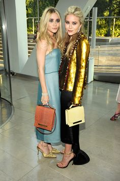 Now here we are in 2011, with both girls in a solid 100mm heel. Ashley is in a fancy mule and MK is in a minimalist sandal.   - ELLE.com