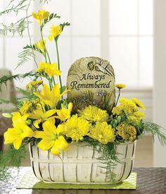 yellow lilies, yarrow, freesia, mums, pittosporum and plumosa