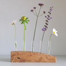 5 STEM FLOWER VASE IN SPALTED ASH - A simple stylish flower stem vase hand crafted in Spalted Ash. This contemporary vase is a great way to have an exuberant display of flowers using only a few stems. I make each vase from an individual piece of wood, hand finished with natural oils to protect it and bring out the natural markings in the timber. A completely unique gift for a wedding, birthday or Christmas, or just a personal indulgence! £55.00