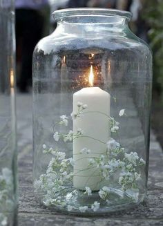 What about candles in blue glass jars with baby's breath and succulents arranged around?