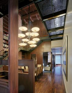 An enormous Bocci chandelier was mounted in a custom arrangement that takes advantage of the atrium's vertical openness.